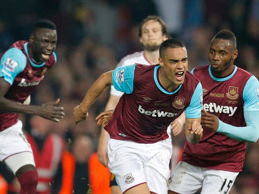 West Ham's Winston Reid celebrates after scoring against Manchester United during the English Premier League soccer match between West Ham and Manchester United at Boleyn Ground stadium in London, Tuesday, May 10, 2016. (AP Photo/Frank Augstein)