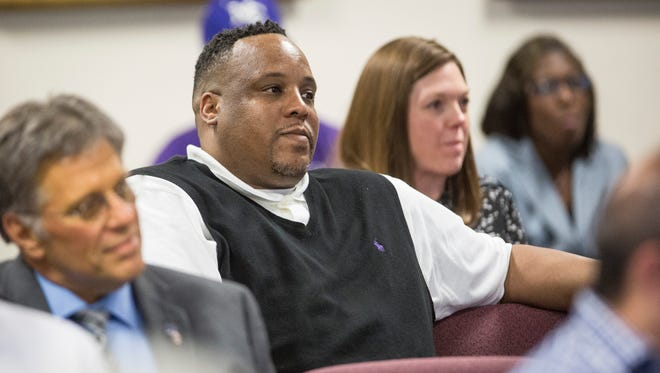 Chandler Thompson, the star on Central's last boys basketball state championship, sits in the audience for the May 23 school board meeting after being hired as the Bearcats' head coach.