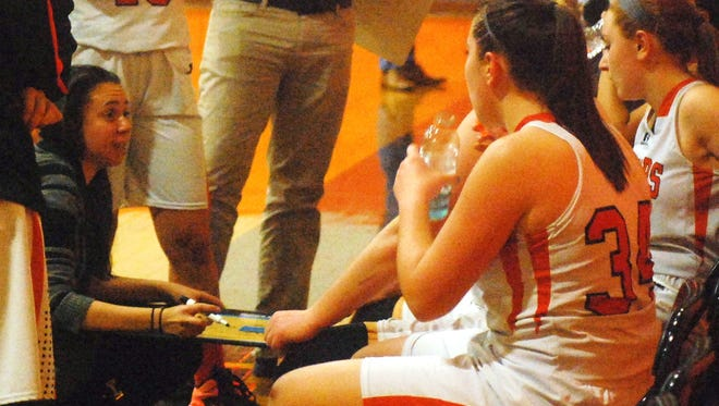 Hasbrouck Heights coach Amanda Minervini talking to her team during a timeout.
