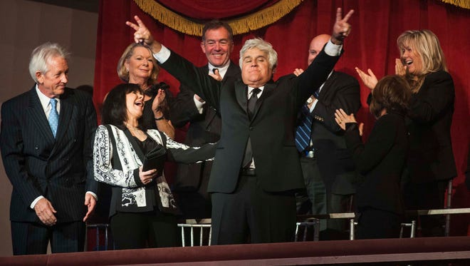 Jay Leno waves to the audience as he is announced at the John F. Kennedy Center for the Performing Arts on Oct. 19 in Washington.