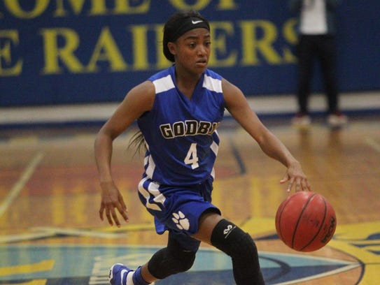 Godby junior Armarni Williams makes a move to the basket