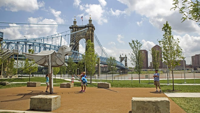 A view of Smale Park overlooking the Ohio River. Opened in 2012, the park attracts families throughout Cincinnati for its open play grounds, walking paths that parallel the river and water splash areas. Tues., June 23, 2015.