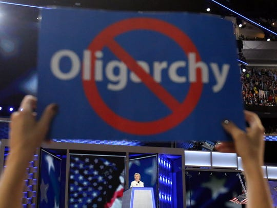 Jul 28, 2016; Philadelphia, PA, USA; A Bernie Sanders supporter holds a sign as Hillary Clinton speaks during the Democratic National Convention at Wells Fargo Arena.