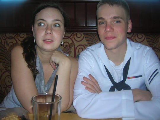 Ben Jernigan, with his sister Amanda Forrester, shortly after he graduated Navy boot camp in 2009. Police are still working to solve his October 2016 killing in North Knoxville.