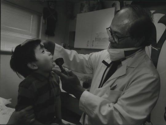 In this 1994 photo Marciano Visaya checks Titus Thao,