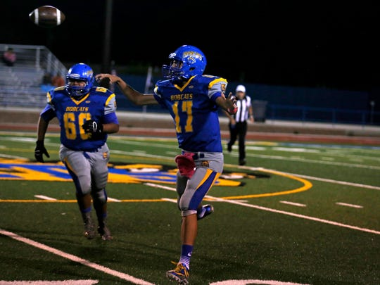 Bloomfield's Brendon Charley completes a pass on Friday