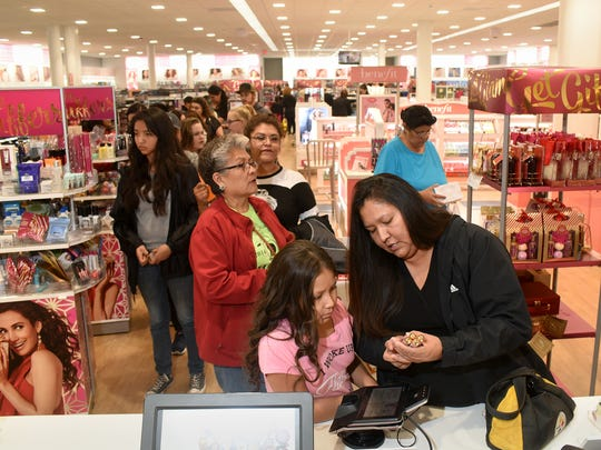 Chevelle Harrison, 9, and her mom, Zorana Begay, shop at Ulta Beauty on Friday at the Animas Valley Mall in Farmington.