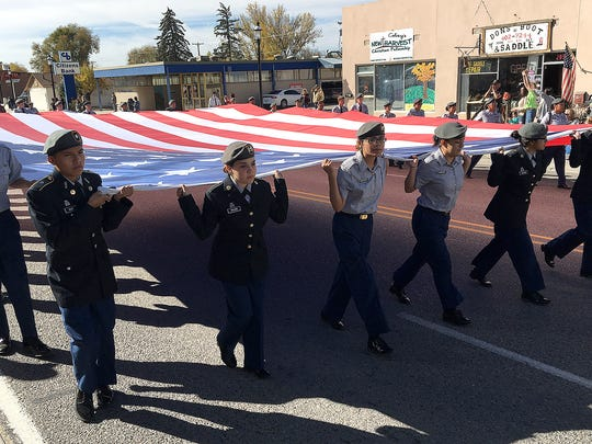 Participants march down Main Avenue during the Veterans Day Parade hosted by VFW Post 614 on Saturday Nov. 12, 2016, in Aztec.