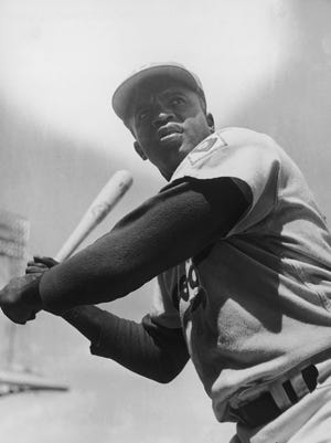 FILE – 9 April 2013:  The movie, '42' released on April 12, 2013 tells the story of Jackie Robinson, the first African American to play in Americas Major League Baseball (MLB) in the modern era for the Brooklyn Dodgers, making his first appearance on April 15, 1947. Robinson died in 1972, aged 53.   American baseball player Jackie Robinson (1919 - 1972) of the Brooklyn Dodgers, circa 1950. (Photo by Curt Gunther/Keystone/Getty Images) ORIG FILE ID: 72723897