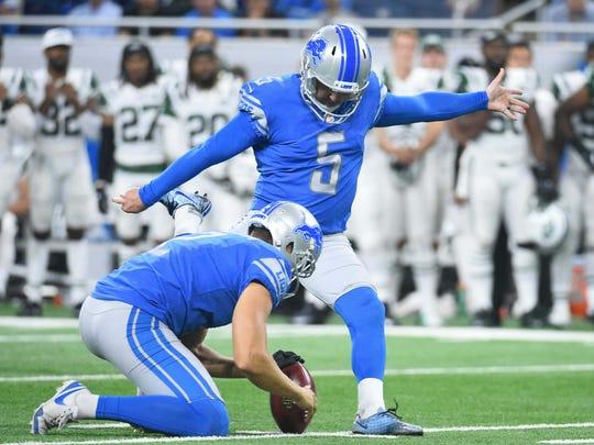 Lions kicker Matt Prater kicks a field goal as punter