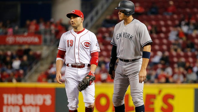 New York Yankees right fielder Aaron Judge (99), stands next to Cincinnati Reds first baseman Joey Votto (19) in the sixth inning.