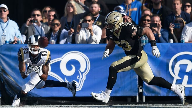 Rams wide receiver Josh Reynolds catches a touchdown pass as Saints outside linebacker A.J. Klein defends during Sunday's game at the Coliseum.