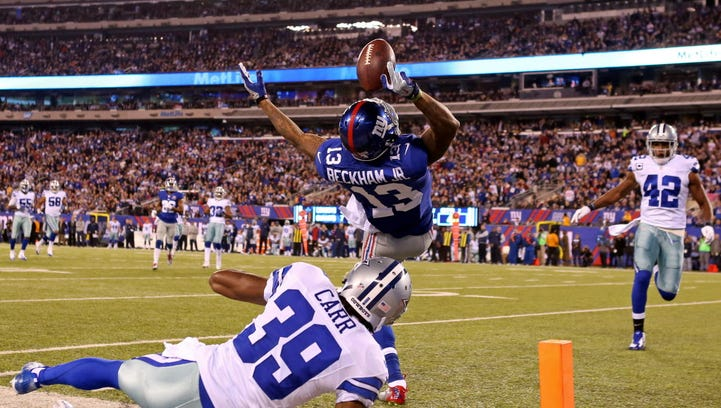 Nov 23, 2014; East Rutherford, NJ, USA; New York Giants wide receiver Odell Beckham (13) catches a touchdown pass over Dallas Cowboys cornerback Brandon Carr (39) during the second quarter at MetLife Stadium. Mandatory Credit: Adam Hunger-USA TODAY Sports ORG XMIT: USATSI-180360 ORIG FILE ID:  20141123_pjc_sh4_164.JPG