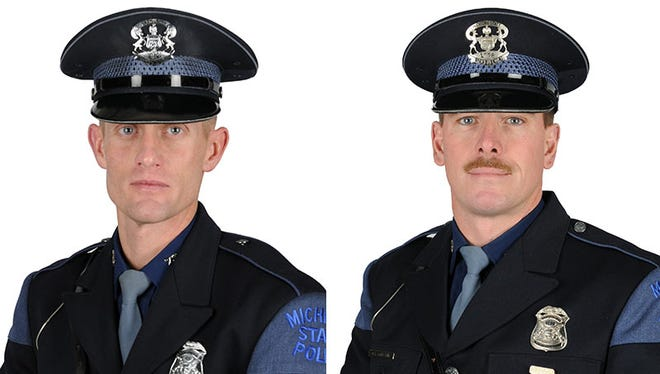 Michigan State Troopers Jim Leonard, left, and Rick Carlson braved a raging house fire to save an unconscious 2-year-old boy.