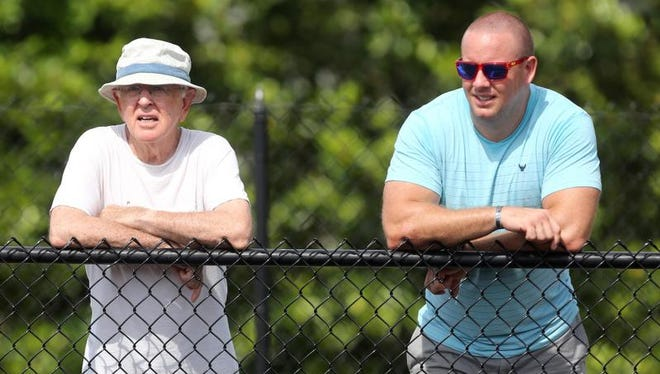 Tennessee Senior Olympics competitor Roland Edwards, 75, left, watches a race with his son Kyle Edwards as he waits for his next event to compete at Battle Ground Academy in Franklin on Sunday, June 21, 2015.