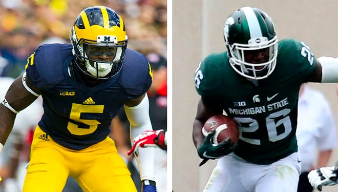 Michigan defensive back Jabrill Peppers, left, and Michigan State DB R.J. Williamson