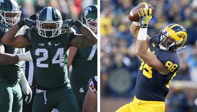 Michigan State running back Gerald Holmes, left, and Michigan tight end Jake Butt