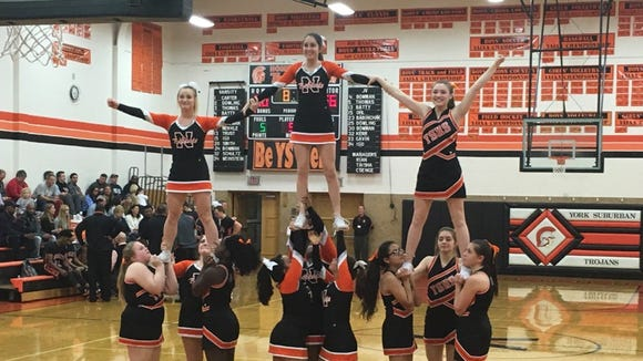 The York suburban and Northeastern cheerleaders cheer together during Friday's boys basketball game