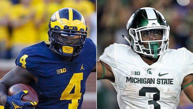 Michigan's De'Veon Smith and Michigan State's L.J. Scott.