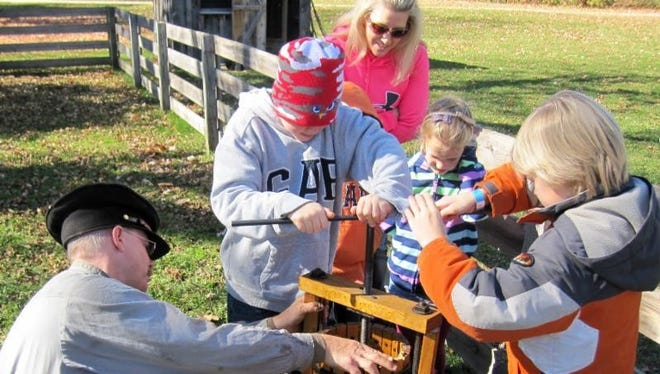 Guests will get to help press apples and try warm apple cider at Wade House's Autumn Celebration.