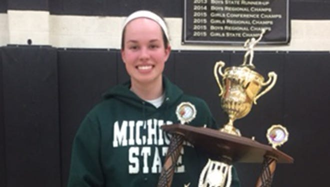 Corunna star Meredith Norris poses with her trophy after being named Michigan Miss Basketball 2016