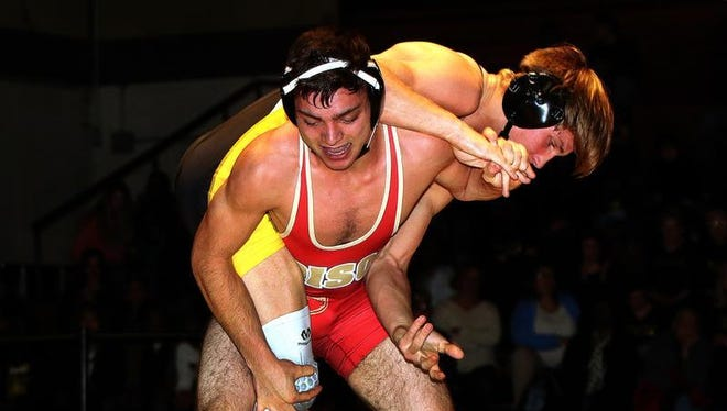 Piscataway's Marcus Petite (top) wrestles Edison's Robert Firestone during their 160-pound bout on Wednesday.