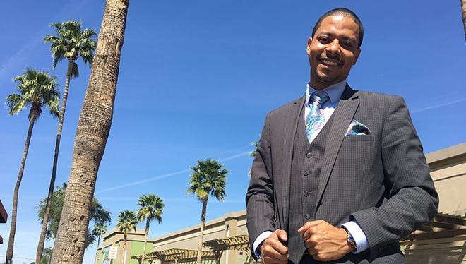Jevin Hodge, vice chair of the Arizona Democratic Party, stands outside of the Gold Bar coffee shop in his hometown of Tempe.