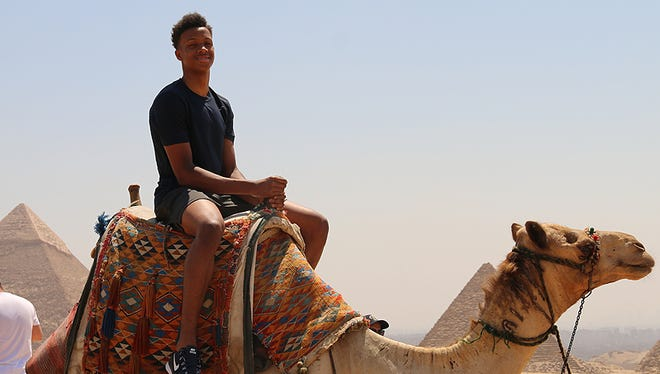 New Albany's Romeo Langford rides a camel in Cairo on Friday June 30, 2017.