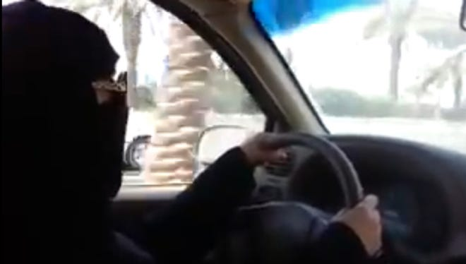 This file image grab from a video uploaded by Saudi activists on YouTube on October 17, 2013, shows a fully veiled woman driving in Riyadh ahead of a then-planned nationwide day of defiance of the ban on women driving.