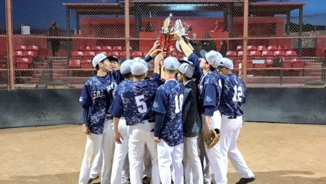 Silver High celebrates with the championship trophy after beating Robertson in the Indian Baseball Invitational final Saturday.