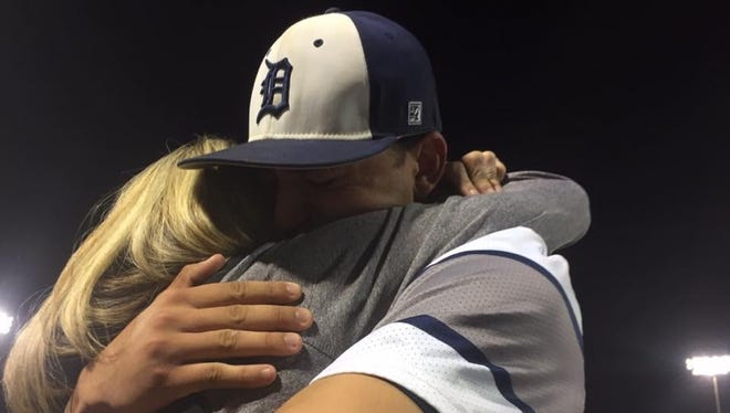 Dallastown's Nick Parker embraces his mother, Jeanie, after the Wildcats captured their first District 3 title by beating Governor Mifflin, 11-1, last June.