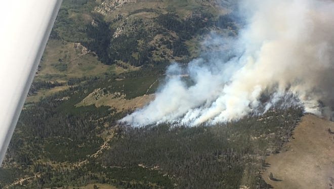A lightning strike in a timbered area caused a wildfire southwest of Augusta that threatened to break out onto prairie lands.