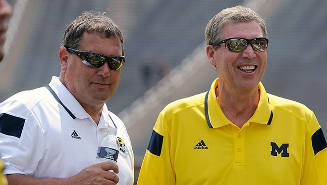 Brady Hoke and Dave Brandon.
