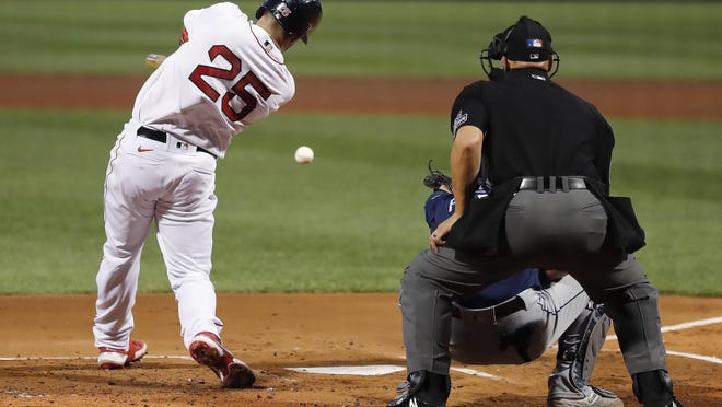 The Red Sox' Kevin Plawecki drills an RBI single during the first inning against the Rays in Monday night's game.