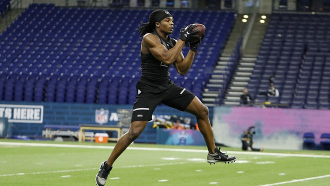 Lenoir-Rhyne defensive back Kyle Dugger, who was the Patriots first pick in the draft, goes through pass catching workout drills during the 2020 NFL Combine at Lucas Oil Stadium on March 1, 2020.