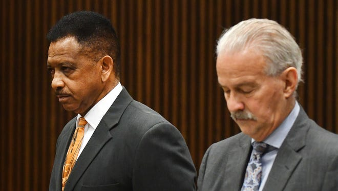 Detroit Police Officer Lonnie Wade, left, with Lawyer Steven Fishman, is sentenced in the courtroom of Wayne County Judge Mariam Bazzi Monday.