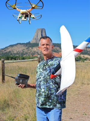 Jim Bowers shows the drones he used to capture aerial video of national parks at Wyoming's Devils Tower National Monument.