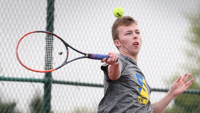 Webster Schroeder's Matt Gamble rips a forehand during his opening match against Geneva's Ryan Fishback during the Section V boys tennis state qualifier in May at Pittsford Mendon High School.  Gamble won the match, and went on to win the singles finals.