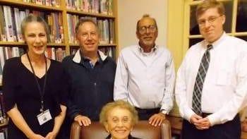 Elberon Branch Manager Linda Wurzel, Cliff Fishman, Robert Fishman, Erik Larsen and Mrs. Ruth Fishman seated in front.