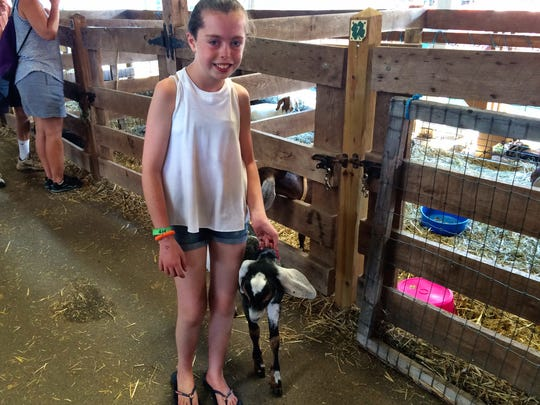Faith Shutlz, 14, of Millbrook shows off her prize-winning goat, Abigail, at the Dutchess County Fair Sunday.