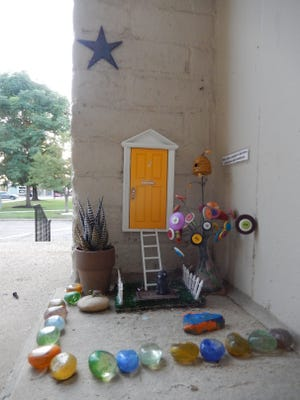 It looks like a family of wee folk have quietly taken up residence at the former Hudson City Hall. This whimsical setup is part of the Fairy Door Project. Visitors to Hudson are encouraged to find these doors.