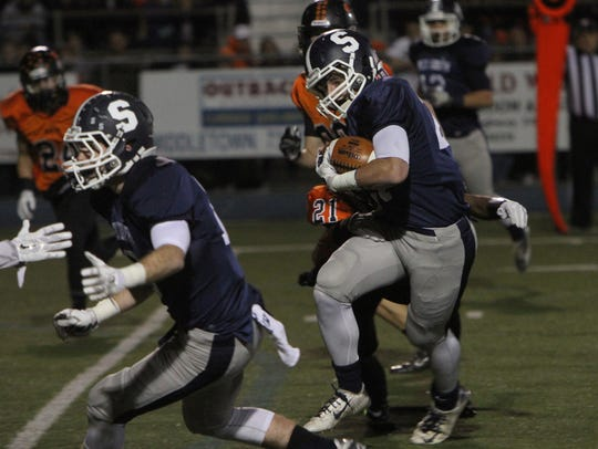 Middletown South's Cole Rogers carries the ball last