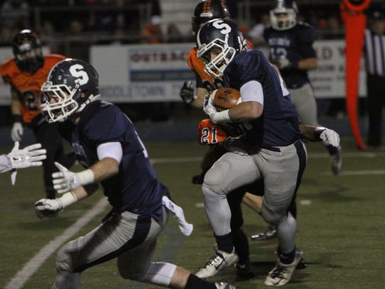 Middletown South's Cole Rogers carries the ball last season for the Eagles.