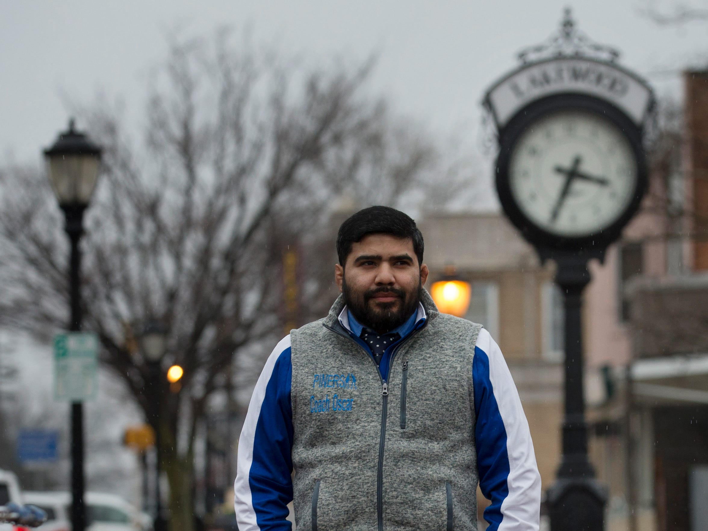 Lakewood wrestling coach Oscar Orellana does some shopping in downtown Lakewood after school as he waits for a wrestling match that night.