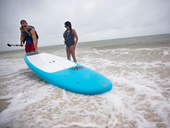 Chris Maleknia and Krystan Betts stop paddleboarding