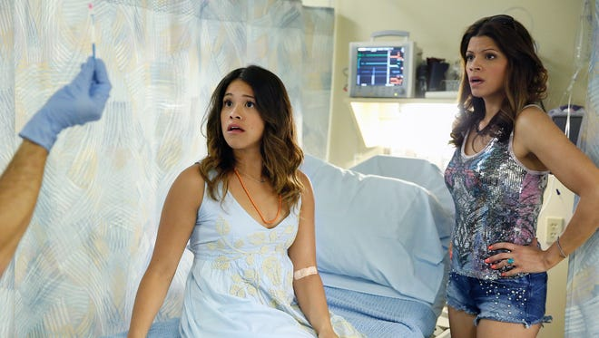Jane, who took her grandmother's words to heart and has remained a virgin until 23, is speechless when her doctor accidentally inseminates her with sperm meant for another patient.  (From left: Gina Rodriguez and Andrea Navedo)