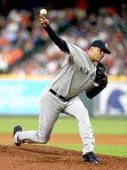 New York Yankees relief pitcher Dellin Betances pitches