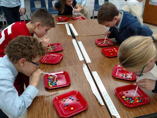 """St. Mary Elementary School fourth-grade students had fun playing """"Minute to Win It"""" games during a recent celebration. Pictured are Tristan King, from left, Anton Jackson, Ellie Brenn, Gabe Groom and Amelia Herzog."""