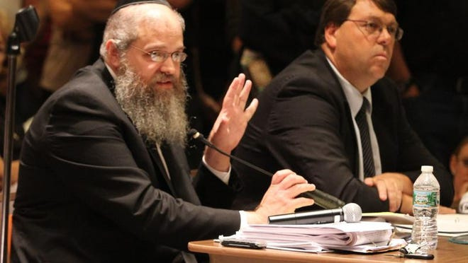 Rabbi Ephraim Birnbaum, the applicant for the Orthodox girls' high school, testifies before the Jackson zoning board at the first hearing in October.