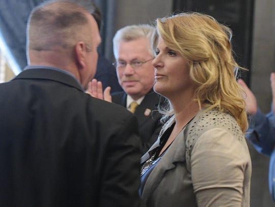 Trisha Yearwood stands with her husband Garth Brooks